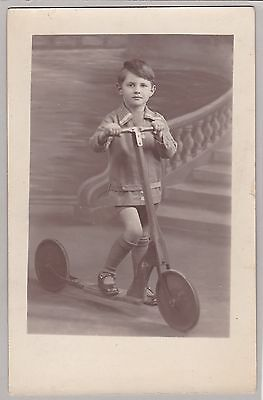 Antique French RPPC: Young Boy Posing With Toy Push Scooter - December 1929