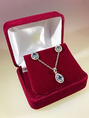 925 Sterling Silver Light Blue Topaz Oval Necklace and Earring Set with Diamonds