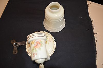 Vintage porcelain wall sconce with glass shade