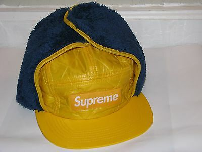 ca22b51be0a SUPREME New York Box Logo Quilted Earflap Camp Cap Yellow Blue S M NEW