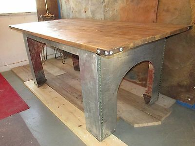 A Stunning large Industrial water tank Dining table with reclaimed pine top
