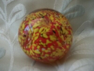 Small glass coloured paperweight