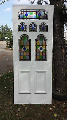 Edwardian 6 panel front door with stained glass.