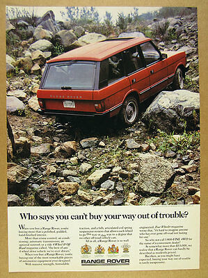 1988 Range Rover Classic red suv rocks boulders photo vintage print Ad