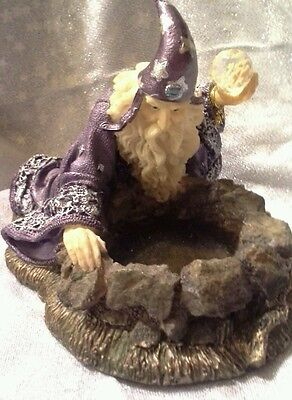 Medieval Legends Merlin scrying in to well with crystal ball