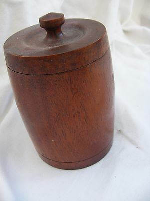 Tube shaped lidded wooden box/container.