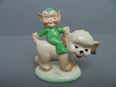 """Shelley Mabel Lucie Attwell """"Riding a smiling dog"""" LA12 gnome figure. C.1940."""