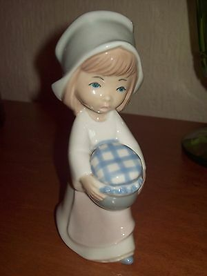 Spanish Casades Porcelain Figure of a girl holding a covered pot .