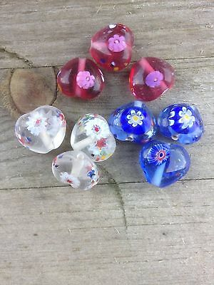 10 millifiori glass heart beads available in pink, blue and white.