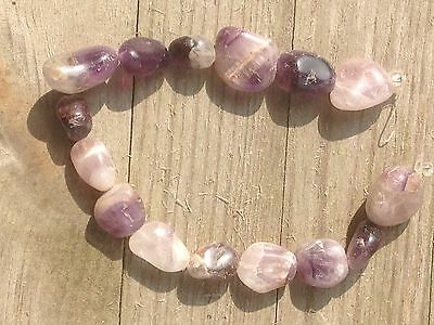 "2 x 8"" rough amethyst bead strands - rough ovals"