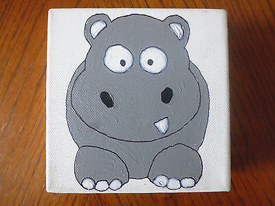 Small oil painting of a Hippopotamus on canvas mounted
