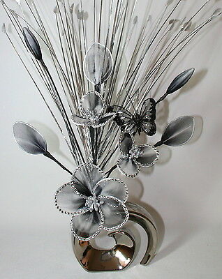 Artificial flower arrangement Black White Glitter Nylon Flowers in Silver Vase.