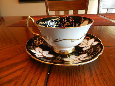 Royal Stuart Cup & Saucer Black & Gold With White Leaves England