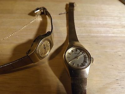 2 working Seiko quartz dress watches with metal bands