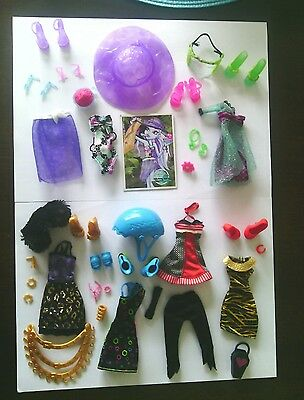 Bulk lot of clothes, shoes and accessories for Monster high dolls.