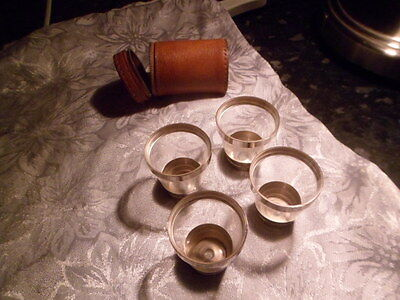 4 small drinking glasses in a laether zipped case
