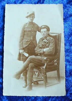 WW1 era photo postcard of two soldiers a Highlander and Artillery man