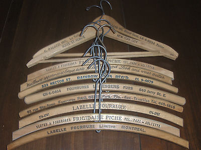 Vtg lot of 10  wood wooden advertising clothe hangers all marked.