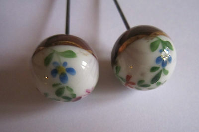 Pair of matching porcelain hat pins