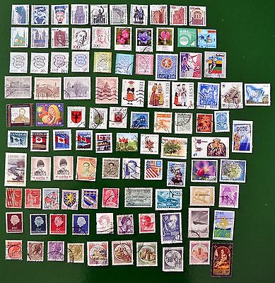 100 used World Stamps – all different – incl Germany, Estonia, Canada, etc