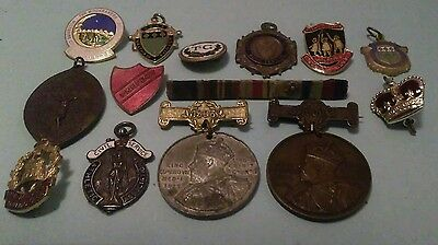 14 medals, medallions and badges. millateria and concil