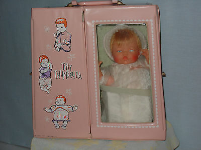 Tiny Thumbelina, all original, tagged dress, EX condition, Works, orig. case VG