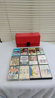 12 rare collectable cassette tapes and a vintage/retro red cassette case