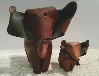 Two beautiful brown origami, deru like, leather elephants