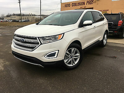 2015 Ford Edge SEL AWD ecoboost 2015 Ford Edge SEL AWD ecoboost leather navigation panoramic rebuilt title !!