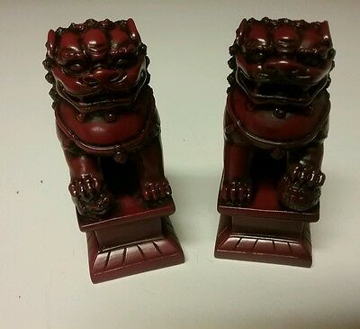 Chinese Foo dogs pair faux cinnibar resin bookends figurines
