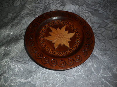 Carved wooden wall plaque with edelweis
