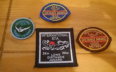 swimming badges job lot. mixed condition