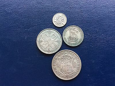 Four George VII silver coins dating from 1931