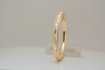 10K gold 8 mm diamond cut bangle/bracelet