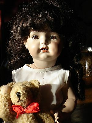 "K & R, S & H 121 Reproduction of an antique doll on composition body 17"" tall"
