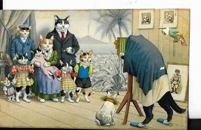 vintage cat themed postcard,cats dressed as human ,made in switzerland