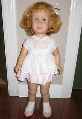 chatty cathy doll by mattel has pull string blue eyes and has a soft face