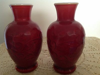 2 x VINTAGE AVON MILK GLASS WITH RED COVERING VASES