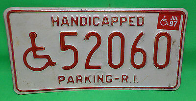 Red on White Rhode Island Handicap License Plate with a 1997 Sticker