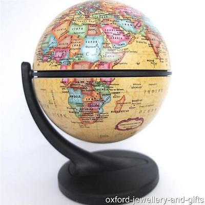 ANTIQUE STYLE ROTATING DESK GLOBE BY WONDERGLOBE. 11cm DIAMETER.  BOXED