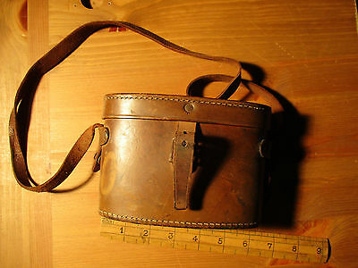 Vintage leather binocular case. Good stitching but stained. Internally worn.