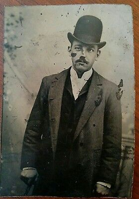 Tintype handsome young mustached man wearing bowler hat & holding walking stick