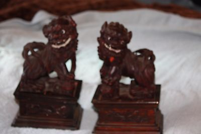 pair  carved wooden asian foo lions/dogs on wooden stands