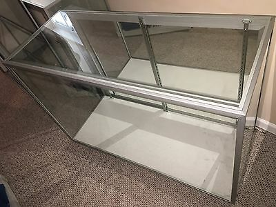 display case with fluorescent light  and 3 glass shelf