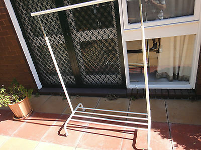 Pair Of Movable And Adjustable Clothing Racks On Castors