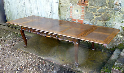A Large French Oak Draw Leaf Table