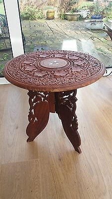 Vintage Asian wooden hand carved table with folding, removable legs