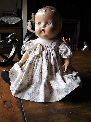 """Vintage all composition baby doll in floral dress. Approx 11"""" tall"""