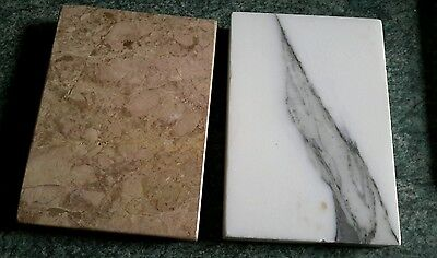 Two small slabs of marble stone two blocks heavy