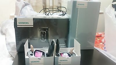 2xSiemens Pure 7mi RCI Digital hearing aids (in beige) with Tek and e-charger